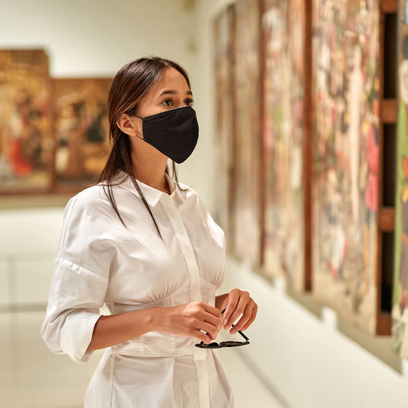 Masked woman at a museum